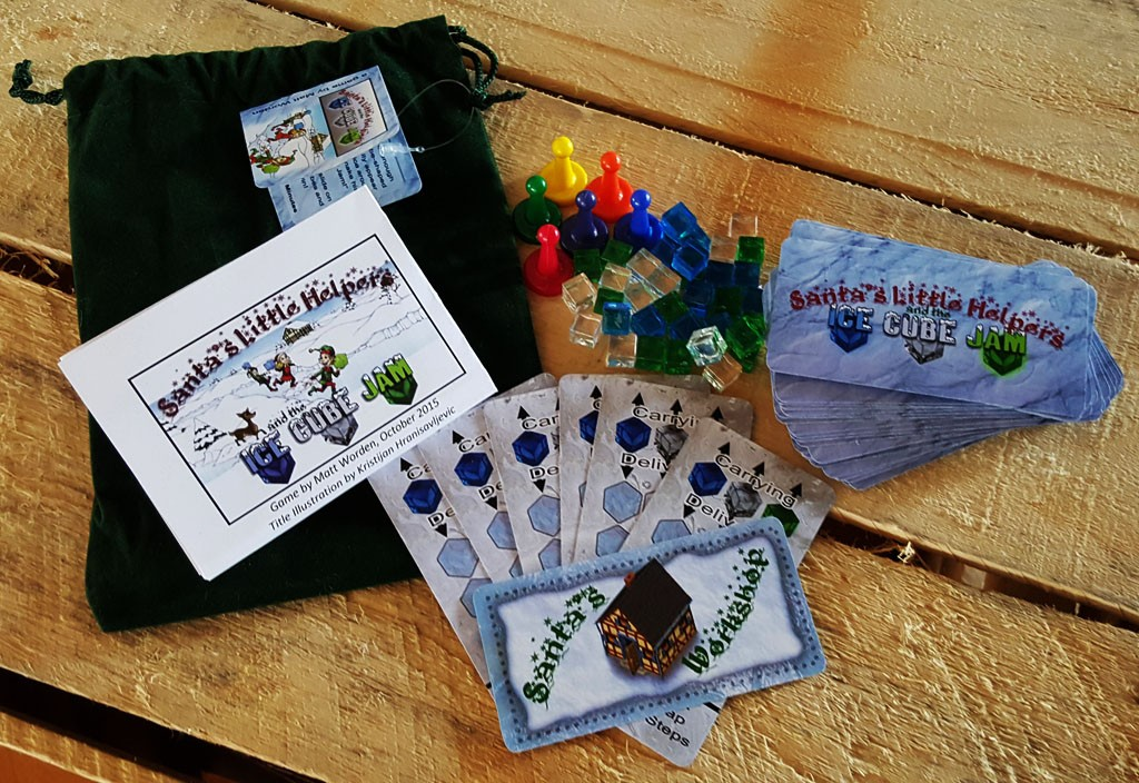 "All components in the Green Gift Bag of ""Santa's Little Helpers and the Ice Cube Jam"""